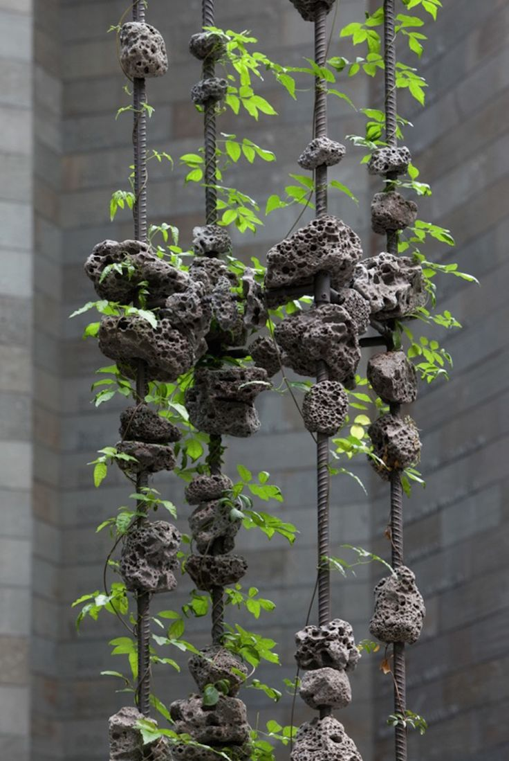 sculptural installations made of concrete and plants. Black Bedroom Furniture Sets. Home Design Ideas