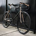 The Madison Street Bike is a made-to-order model reminiscent of a vintage track bicycle. Detroit Bicycle Company bikes are functional works of art. This sharp design stands out with its unique copper-plated frame and black details. You won't find another like it!