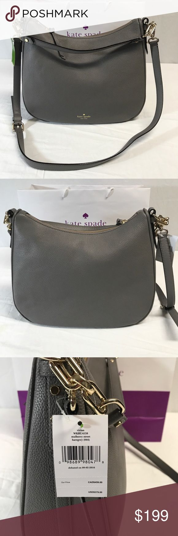 Kate spade gray pebbled leather handbag Gray pebbled leather handbag. Shoulder bag is 10 inches across zipper, cross body handle drop is 21 inches. Gray fabric inside with goldtone hardware. One Shorthandle one Crossbody handle. Bottom of bag is 13 inches across. the height is approximately 10 inches. The depth at the widest point is 5 inches. Kate spade New York Bags Shoulder Bags