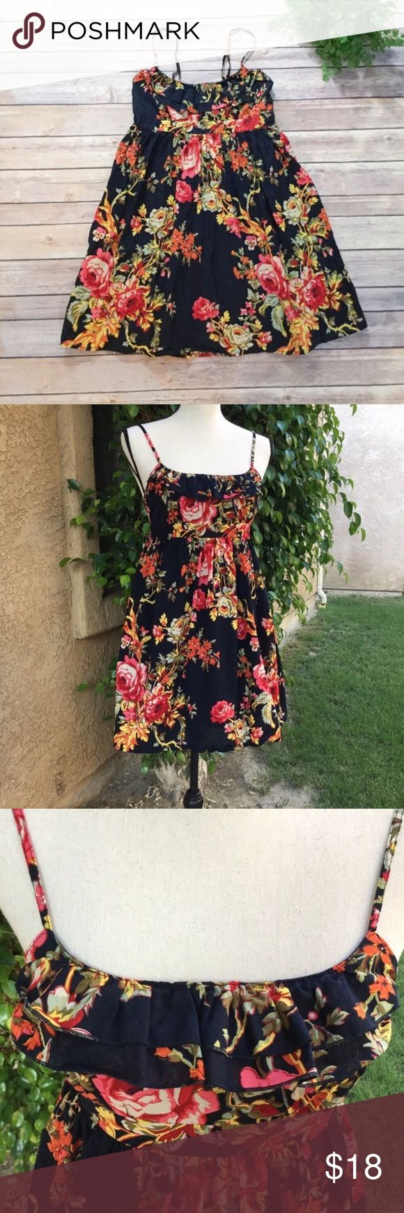"""Xhilaration Floral Fit Flare Sleeveless Dress M 🍃 I thought this was black, but in the sunlight it looks very dark blue. Double ruffle around the top, adjustable straps. Back has elastic smocking and ties. Skirt portion is lined. Xhilaration size medium. So cute with cowboy boots and a cardigan or denim jacket. Perfect for holiday parties.    Chest-28"""" Waist-28"""" Length-23"""", taken from side seam at the underarm.   🌸 Fabric-100% cotton 🌸 Condition-Excellent pre owned condition 🌸  Boho…"""