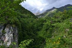 A panoramic view to Italian Alps canyons. Royalty Free Stock Photos