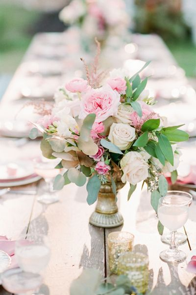 Pretty pink and white arrangement in a gold pedestal bowl. #wedding #flowers #centerpiece