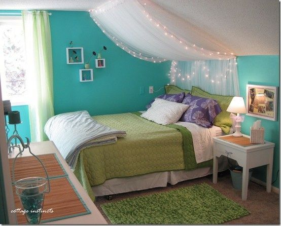 Cute idea for my daughters' room. I love the lights and fabric above the bed.