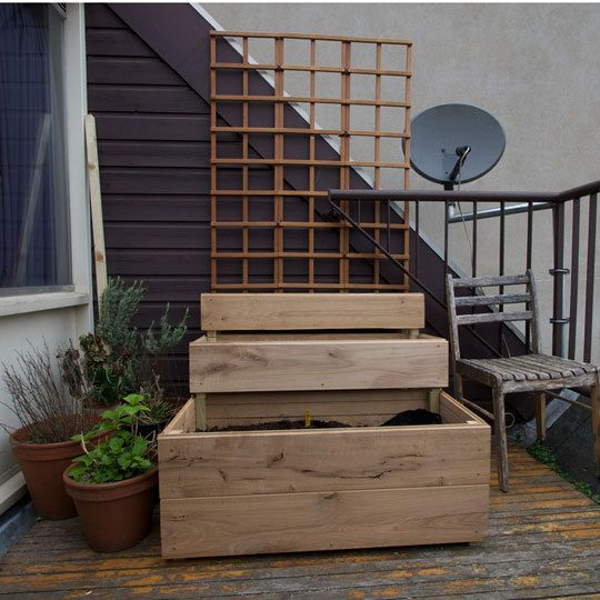 Fun patio gardening design from theKitchn! What a great container garden design! There is a deep box for larger vegetables to dig their roots deep, then smaller boxes for greens, and a top box with a trellis for climbing beans and tomatoes.