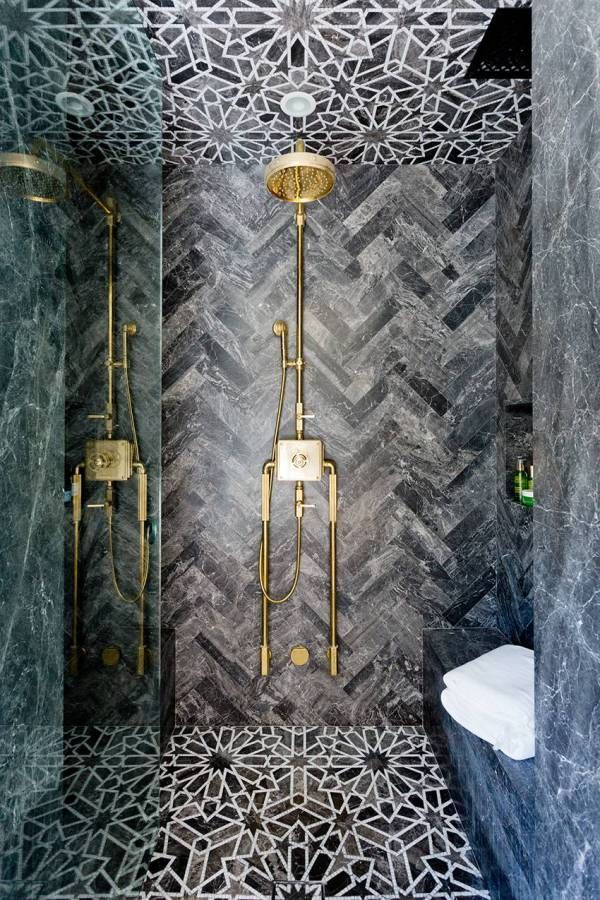 Dark Grey Marble Shower Tiles Stand In Shower With Gold Fixtures