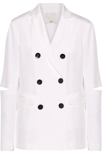 Tibi's white blazer is updated with unexpected details including subtle elbow cutouts. Tailored from fluid silk crepe de chine, it has a double-breasted front and side slits. Complement the contrasting buttons with black accessories.