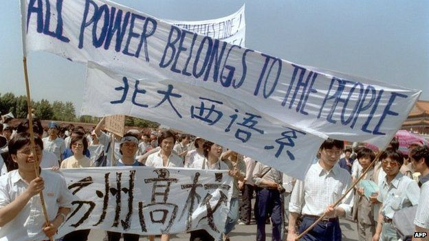 Waving banners, high school students march in Beijing streets near Tiananmen Square on 25 May 1989 during a rally to support the pro-democracy protest against the Chinese government