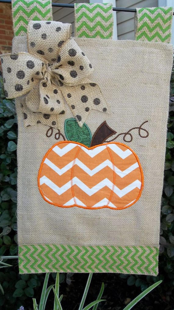 - Handmade item - Materials: burlap, embroidery, orange cotton chevron, ribbon This flag is 12 x 18 and ready for your yard. The flag has a large orange and white pumpkin ready to welcome your visitor