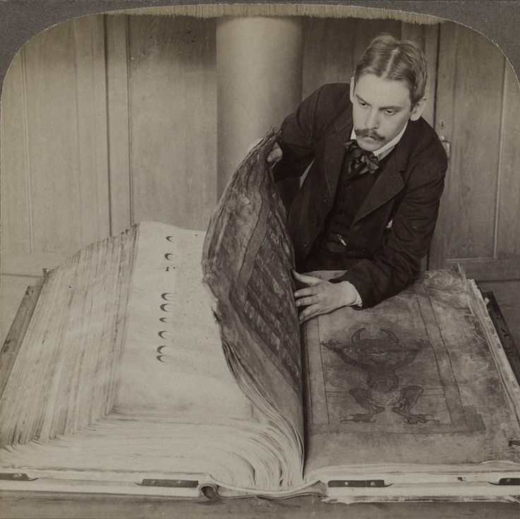 "Codex Gigas, world's largest extant medieval illuminated manuscript: 13th century handwritten Old & New Testament w/ other texts, 620 p. nearly 3 ft high, 165 lbs. bound in wood covered w/ leather and ornate metal…nicknamed ""Devil's Bible"" for full page image of devil … legend that single scribe who wrote the giant book made deal with the devil to complete the work in a single night, prob. from Bohemia (Czech Republic) … 1906 stereoscopic image / National Library of Sweden, Stockholm, Sweden"