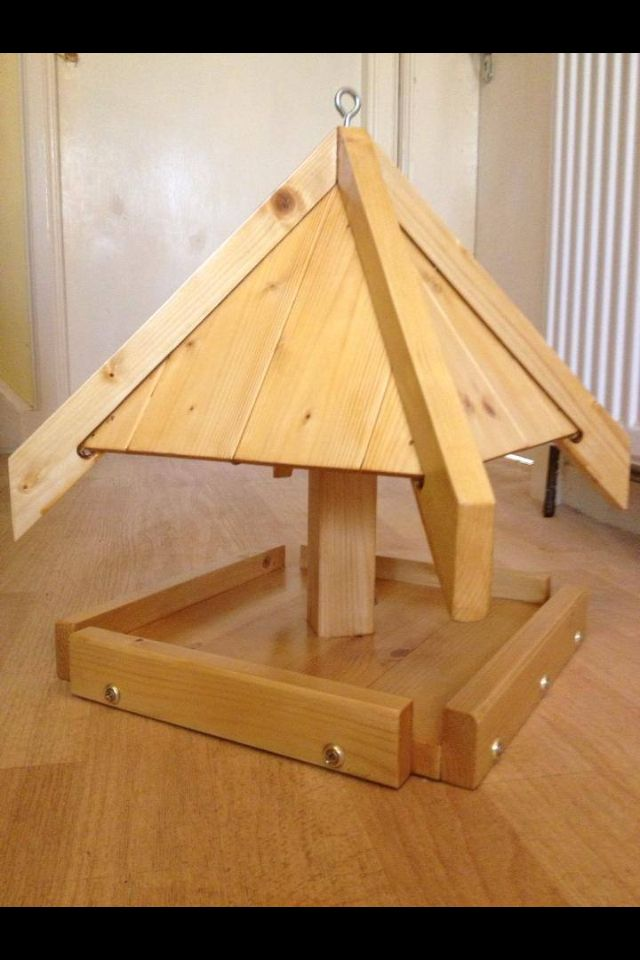 Hanging pagoda bird table. Hang from chain or fit on top of post. Durable varnish finish.