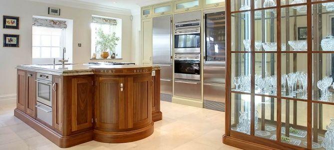 Walnut bespoke kitchen in a timeless in-frame shaker style.