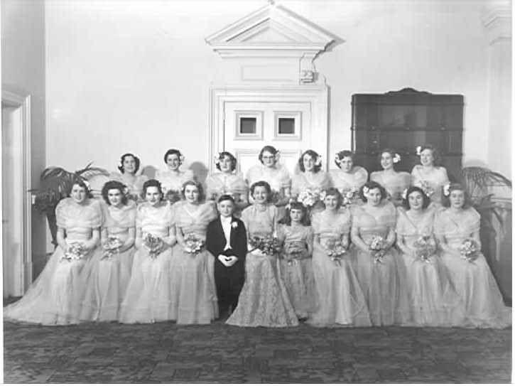 PH 2321.  Debutantes, mayoress, page boy and flower girl at the Mayoral Ball, Prahran Town Hall; June 1950.