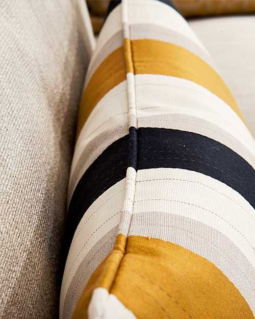 Scatter cushion, smart varied stripe in tightly woven jacquard weave. Piped edge detailing, zip opening with feather inner.