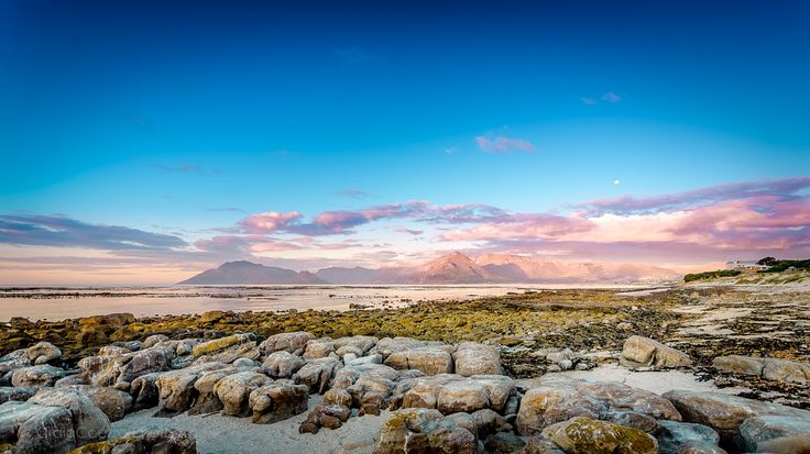 Magnificent Mountain  This is a photo I took just before 8pm one evening in Cape Town, Kommetjie, South Africa on 15 December 2013.  I was amazed at how beautifully the mountains lit up with the sunset that was unfolding behind me and already touching the horizon.  The moon had already made an appearance for the evening and the sky was starting to turn a beautiful dark blue/purple shade, otherwise also know as civil twilight.