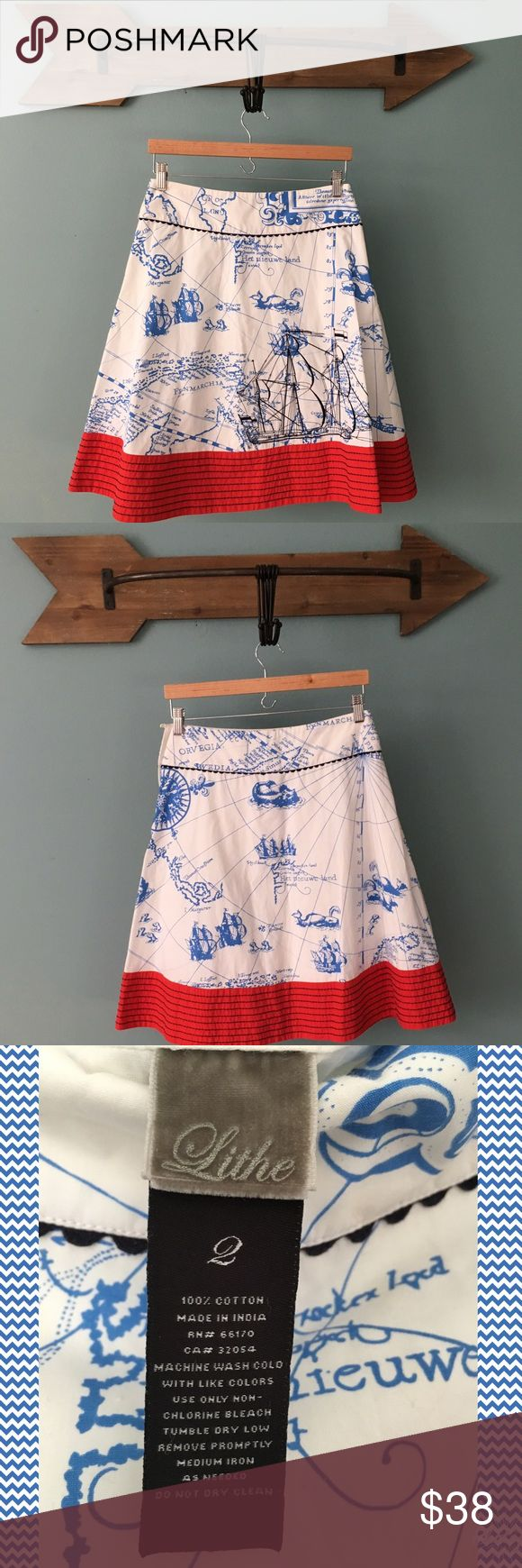 """Anthropologie Lithe Rare Seafarer's Map Skirt Rare Anthro Lithe Seafarer's Map Skirt.  ⚓️From Anthro Archive Website:  An embroidered schooner sails through periwinkle oceans on crisp cotton poplin, buoyed by a vivid red border. By Lithe. Side zip Cotton; cotton lining Machine wash 23""""L  🚭Nonsmoking Home. ✅Pet friendly. We have a Morkie. 🚫Sorry No Trading. Anthropologie Skirts Midi"""