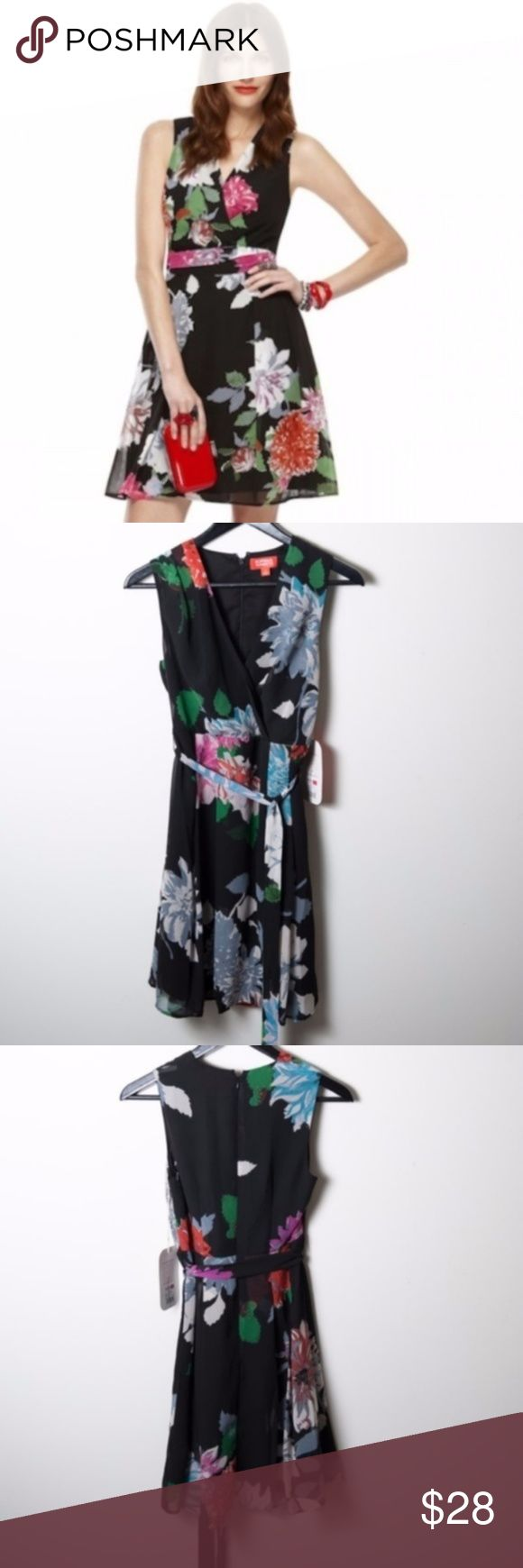 NWT Kirna Zabete Black Floral V-Neck Dress Flowers Kirna Zabete for Target. Black sleeveless dress with bold floral pattern. Red, fuchsia, turquoise and gray flowers with green foliage accents. Wraparound v-neckline, pleats on right shoulder drapes into a faux wraparound, v-neckline. Large pin tucks around waistline, spills open to a flowing chiffon skirt. Sheer dress, with solid black layer underneath. Hidden back zipper with hook and eye closure. Matching fabric sash to be worn tied around…