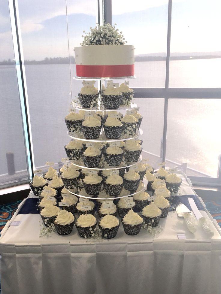 Chocolate mud & white chocolate mud cupcakes & white chocolate mud cutting cake with white chocolate collar & babies breath. Beautiful for a wedding.