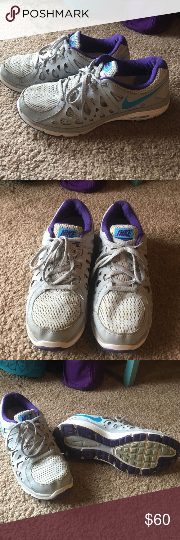 Nike Dual Fusion shoes - Women's size 10 Purple and grey Nike shoes. Fitsole. Worn only a few times for work. Barely broken in. Women's size 10. Make an offer! Nike Shoes Athletic Shoes