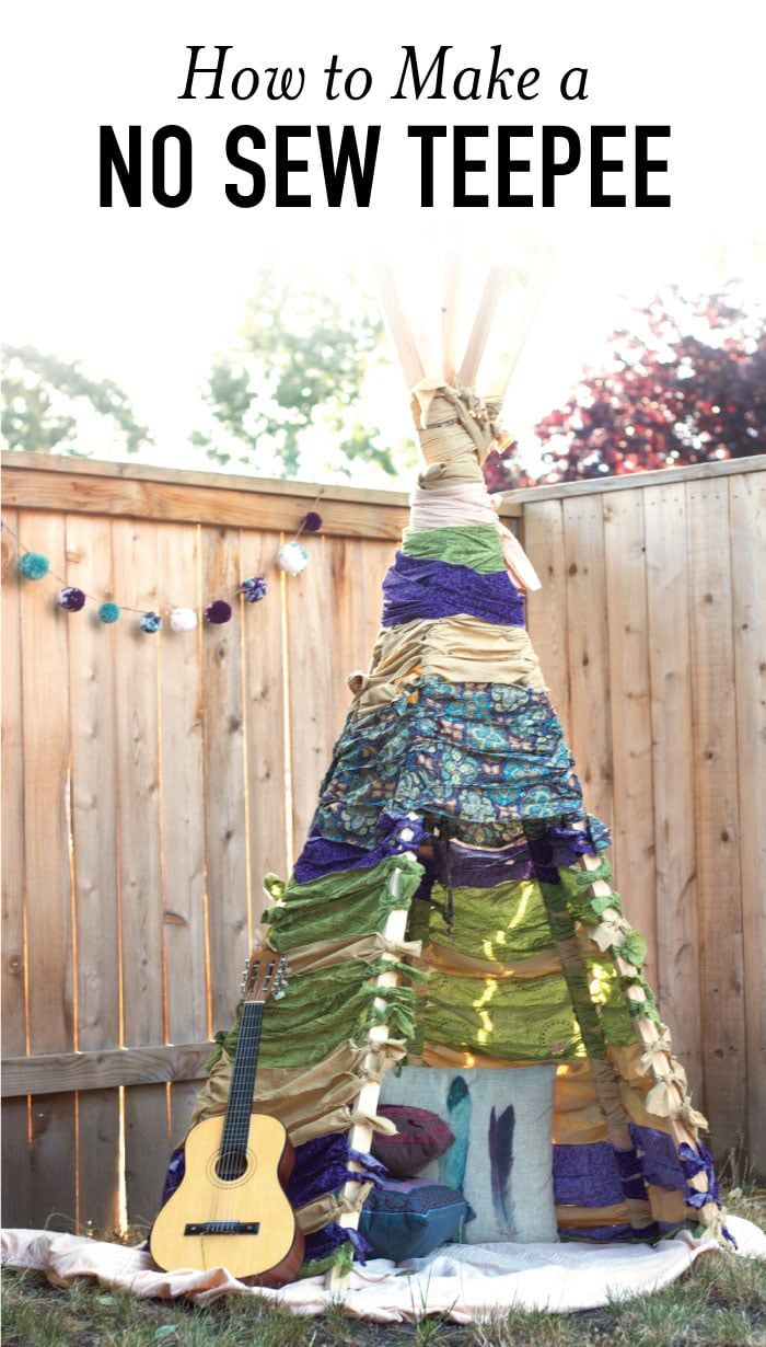Build this no sew teepee that is perfect for forts, reading in the shade outside, or just for some fun imagination play. Make this easy DIY using this tutorial. #nosew #teepee #diyproject #diyforkids via @acraftedpassion