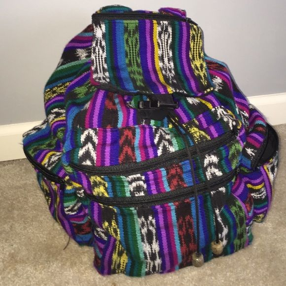 Tribal Guatemalan Backpack ✨ Backpack made in Guatemala. The colors are so vibrant and amazing. There is TONS of room inside, an interior zip pocket, 2 front exterior, 2 side zip pockets & one on the flap. It is a drawstring & latch closure. No signs of wear except the left side pocket does not zip anymore. This backpack is great for music festivals, hiking, traveling or school!  Bags Backpacks