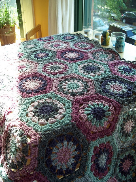 Hexagon afghan in shades or purple and green. These colors are gorgeous!!!!