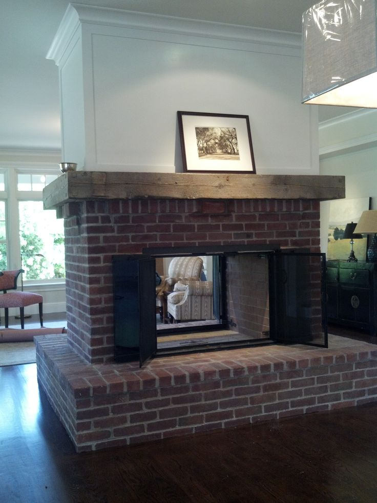 Beautiful see-through fireplace by DC Stoneworks  www.dcstoneworks.com