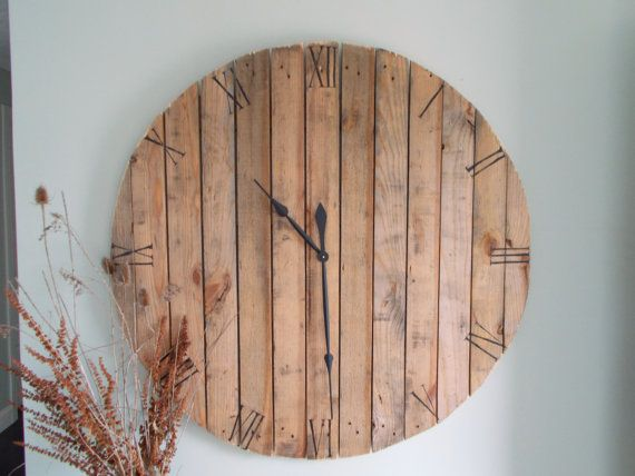 This one of a kind, charming, pallet wall clock is all handmade and hand stenciled with working clock parts. Made of pine it includes a 17 3/4 black