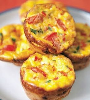 ... egg mix in 8 muffin cups, & add onion, bacon & tomato mix equally