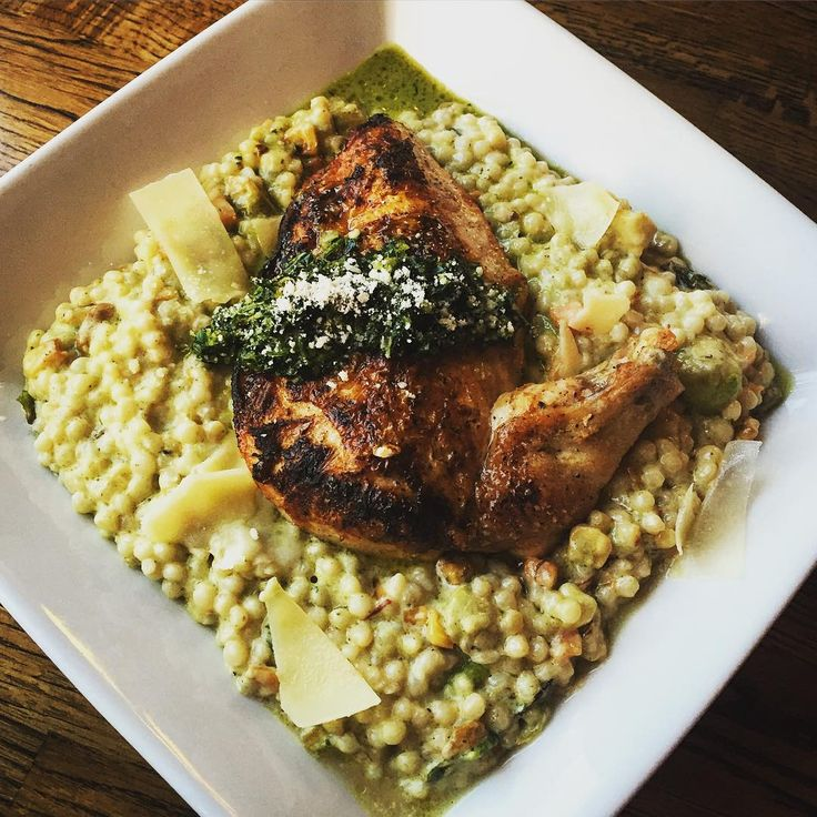Brined and pan-seared chicken breast served over winter vegetables and pearl couscous risotto. Garnished with honey gremolata and shaved Parmesan cheese.