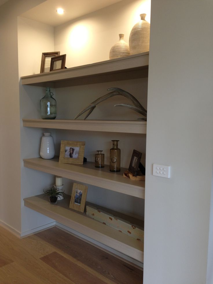 Shelves in the entrance way for display