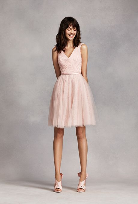 Brides.com: . Style VW360206, short sleeveless tulle over lace dress with gathered skirt, $189, White by Vera Wang available at David's Bridal