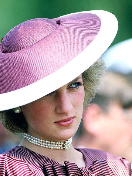 Diana sported a saucer hat by Frederick Fox during a 1985 visit to Anzio in Italy.