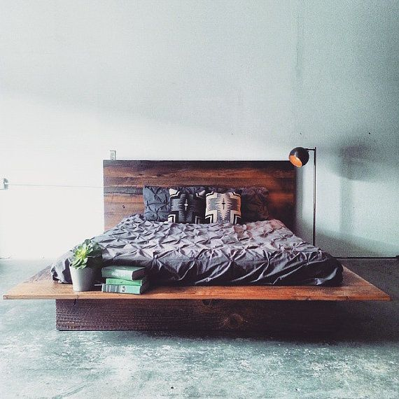 Our custom made barn wood platform bed boasts a modern shape and contrasted with rustic material. Made from old growth Douglas Fir timber reclaimed: