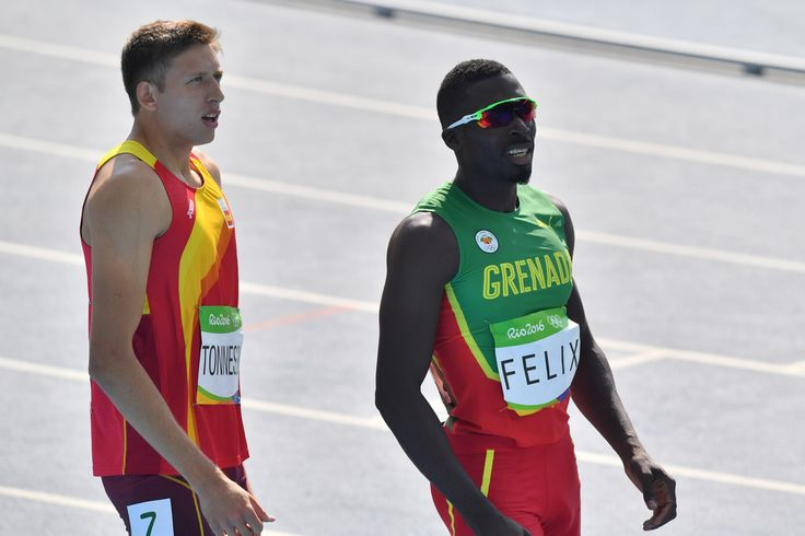 Grenada's Kurt Felix (R) and Spain's Pau Tonnesen look at the results board after competing in the Men's Decathlon 100m during the athletics event at the Rio 2016 Olympic Games at the Olympic Stadium in Rio de Janeiro on August 17, 2016. / AFP / PEDRO UGARTE  (Aug. 16, 2016 - Source: AFP)