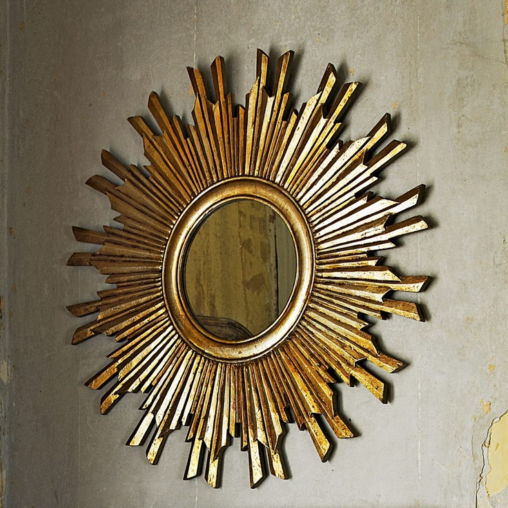 This Carved Wooden Sunbeam Mirror In Gold Will Add Warmth
