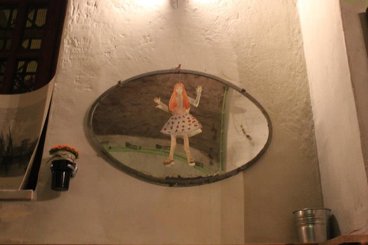 Old mirror with Girl and Flower, Re-Cycle Café, Civitavecchia, Italy.