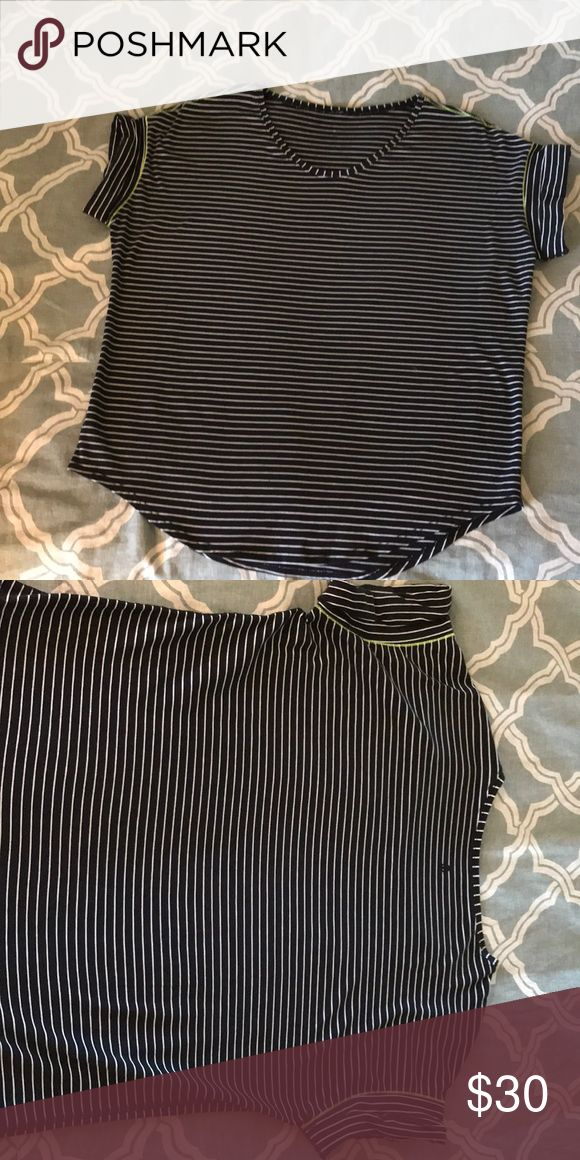 Lululemon Shirt Black and white stripes, bright yellow stitching on sleeves. Folded sleeve, scoop neck. Loose fit, great quality, very soft and comfortable. lululemon athletica Tops Tees - Short Sleeve