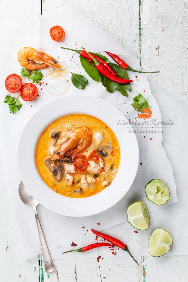 "Spicy Thai Soup ""Tom Yam"" with Coconut Milk, Chili Pepper and Seafood 