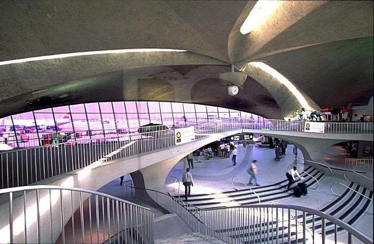 TWA Terminal, Kennedy Airport, New York City (1956-62)  -Architect: Eero Saarinen  -organic shapes inside and out  -thin concrete shell structure  -derived from the catenary arch