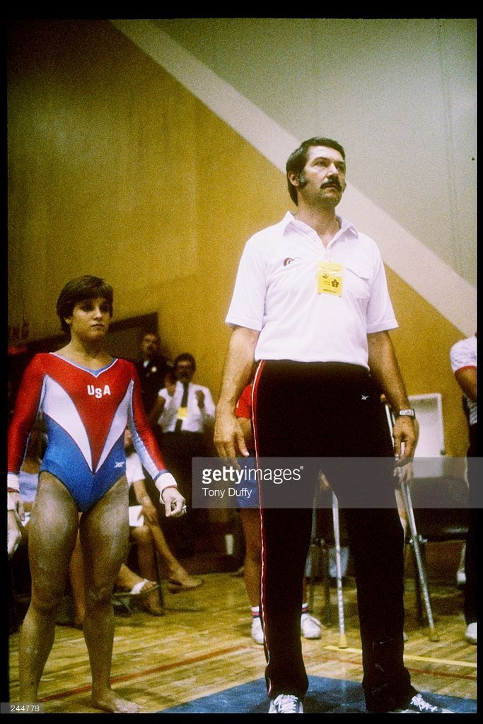 --1983--Mary Lou Retton of the United States (left) stands with her coach Bela Karolyi. Mandatory Credit: Tony Duffy /Allsport