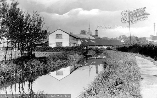 Stowmarket, The River 1922. Looking west from the canal towpath towards the town, with the church spire in the centre distance. Out of view to the right are the railway line and the Suffolk Iron Foundry. #Stowmarket #Rivers