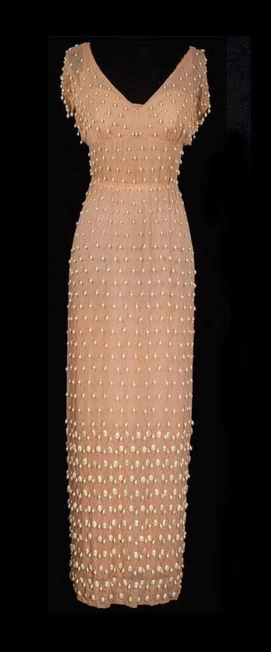 "Sheer nude chiffon dress, beaded with hundreds of faux pearls and gold thread in a diamond pattern at sleeves and lower skirt.  Worn by Rita Hayworth in the 1953 film ""Salome"".  Dress design by Jean Louis  ( http://en.wikipedia.org/wiki/Jean_Louis )"