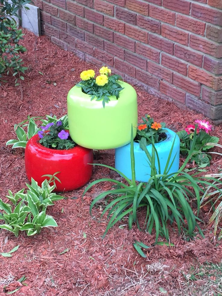Planters made from old go kart racing tires and a can of spray paint. Inserted clay trays in bottom to prevent dirt from coming through.