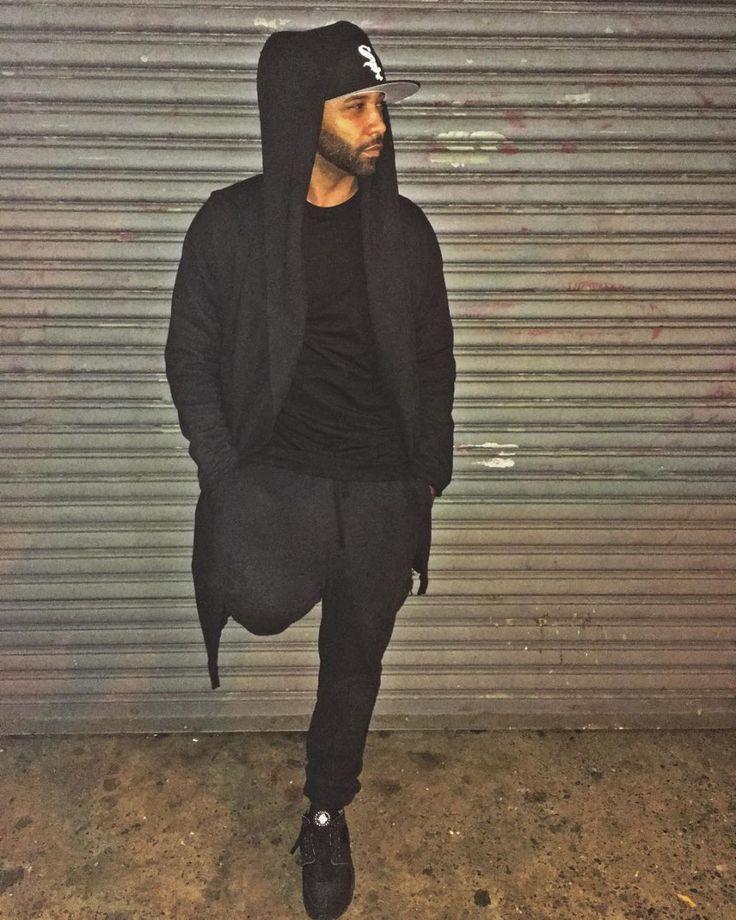 Joe Budden wearing the 'Blackout' Nike Air Huarache