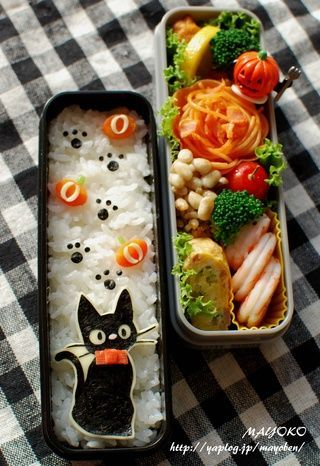 """""""Jiji the cat"""" character bento box, made from cheese, nori, and carrot."""