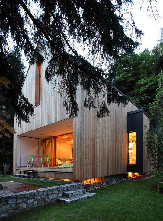 "Domesi, weekend cottage, Czech Republic by Architect Pavel Horák of Prodesi An old stone basement served as the foundation. simple ""house"" shape, clad in untreated larch — a bountiful local hardwood known for its toughness."