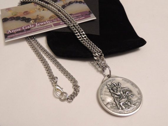 Necklace by Anne Gale Jewels  Saint Christopher / Our Lady of the Highway Safe Travel - Large Round Medallion Necklace  Stainless Steel Link Chain with parrot clasp  Medallion size - 4cm Height - (1 .5 inch Height) - Silver oxidised Medal - Made in Italy  Large heavy medal with beautiful detail - St Christopher Protect us with Our Lady of the Highway on Reverse  Stainless Steel Chain 4mm thickness (1/8 inch)  Choose your length 24 inch - 60cm 28 inch - 70cm 32 inch - 80cm  Necklace will be…