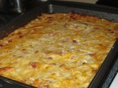 Cheesy Hashbrown Casserole with Ham    4 cups of frozen hashbrown potatoes  2 cups mild cheddar cheese  1/2 cup milk  1/2 stick of butter  1 cup of diced ham or cooked bacon (deli meat works fine)  mix together then place in a well butter baking dish and bake for 45 minutes on 375.   Jen