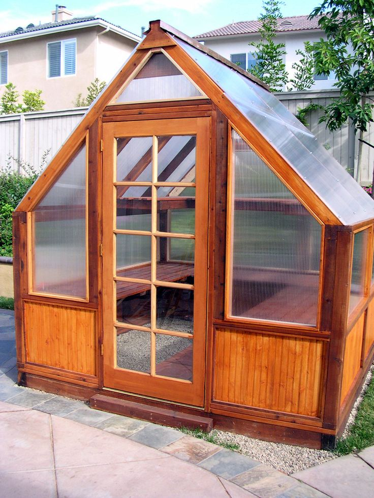 Greenhouse with cedar basewalls and Lexan panels.