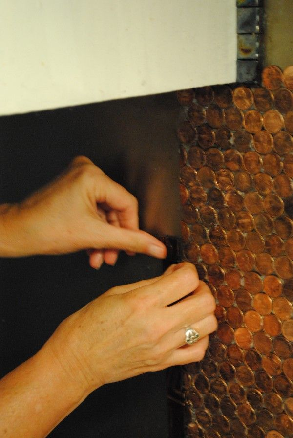 She also lined the backsplash with glass copper tiles. She used the same adhesive to apply them.
